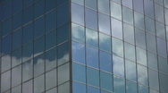Stock Video Footage of Office windows reflect clouds.