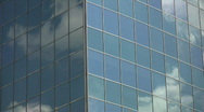 Office windows reflect clouds. Timelapse. Stock Footage