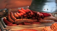 Cook prepares sausage, hot dogs and chicken at county fair. Stock Footage