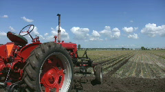Red tractor and field. Stock Footage