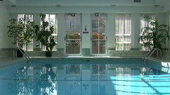 Man Walks By Indoor Pool (HD 1080p30) Stock Footage