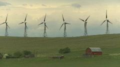 Wind turbines on ridge, #26 and farm Stock Footage