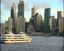 Sydney Harbour Skyline and Cruise Boat - stock footage