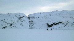 Man pulling Sledge Tasiilaq Greenland Stock Footage