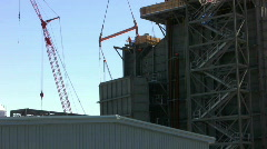 Ironworker guide crane lift on construction site Stock Footage