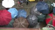 China Hong Kong Tropical typhoon monsoon raining umbrellas Stock Footage