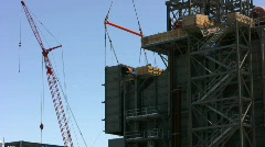 Ironworker positions large duct on construction site Stock Footage