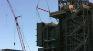 Stock Video Footage of ironworker positions large duct on construction site
