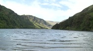 Stock Video Footage of Glendalough Main Lake with Mountains
