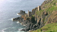 Ruined tin mine pumping engine houses at Botallack Cornwall  Stock Footage