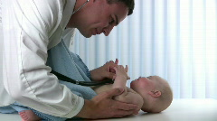 Male Doctor Checking Baby - stock footage