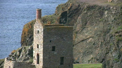 Ruined tin mine pumping engine houses at Botallack Cornwall  - stock footage