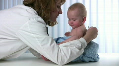 Doctor Checks Baby - stock footage