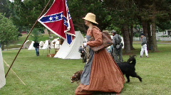 Confederate camp - Southern woman walking her dogs Stock Footage