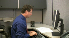 Man on PC in office Stock Footage