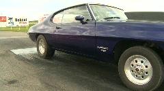 Motorsports, drag racing purple pontiac burnout Stock Footage