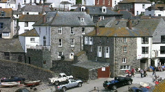 Cars parked at low tide in Port Isaac harbour in Cornwall England. Stock Footage