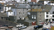 Stock Video Footage of Cars parked at low tide in Port Isaac harbour in Cornwall England.