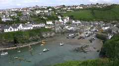 Boats moored at low tide in Port Isaac harbour in Cornwall England. Stock Footage