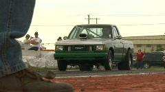 Motorsports, drag racing green GMC pickup burnout slomo Stock Footage