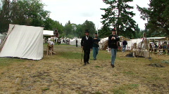 President Lincoln walks through the Union camp Stock Footage