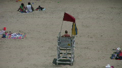 Lifeguard stand with red flag warning Stock Footage