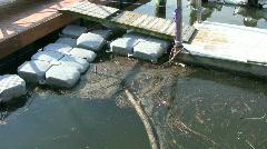 Marina debris in water Stock Footage