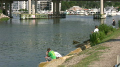 Boy fishing at Rudee Inlet Stock Footage