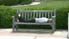 Man sleeping on bench Stock Footage