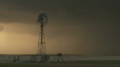Windmill with ominous stormy skies Stock Footage