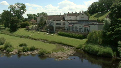 River Tees at Piercebridge on a summers day pan from George Hotel Stock Footage