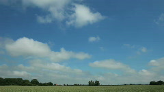 Timelapse clouds over green wheat field 1 - stock footage