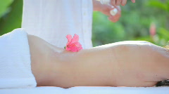 Massage with flower part I Stock Footage
