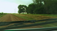 Stock Video Footage of Tornado with debris cloud seen from storm chasers vehicle