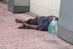 Homeless Man Sleeping On Sidewalk Stock Footage