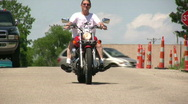 Man on Motorcycle driving towards camera Stock Footage