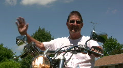 Man on Motorcycle giving Thumbs Up front view Stock Footage