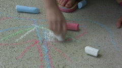 Child using Sidewalk Chalk Stock Footage