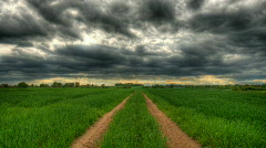 Storm clouds passing over prairie hdr time lapse Stock Footage