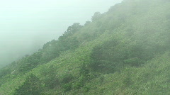 Clouds Swirl Up Mountain Side Stock Footage