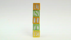 Wooden building blocks UNITE  HD  Stock Footage