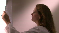 Physician lightbox looks at film Stock Footage