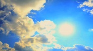 Stock Video Footage of Puffy Clouds time lapse with sun rays