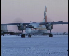 Landing on icy airfield - stock footage
