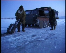 Emergency repair of cross-country vehicle in ice tundra Stock Footage