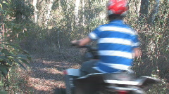 Rider on ATV on trail clip 3 Stock Footage