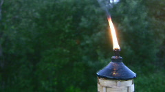 Tiki Torch Burning Flame At Twilight Outdoor Garden Stock Footage