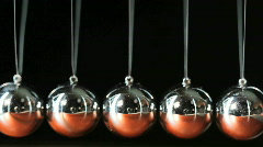 Close up of Newton's Cradle Desktop Toy in Motion - stock footage