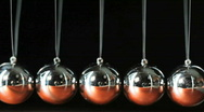 Close up of Newton's Cradle Desktop Toy in Motion Stock Footage