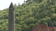Stock Video Footage of Glendalough Round Tower Tilt Down and Up